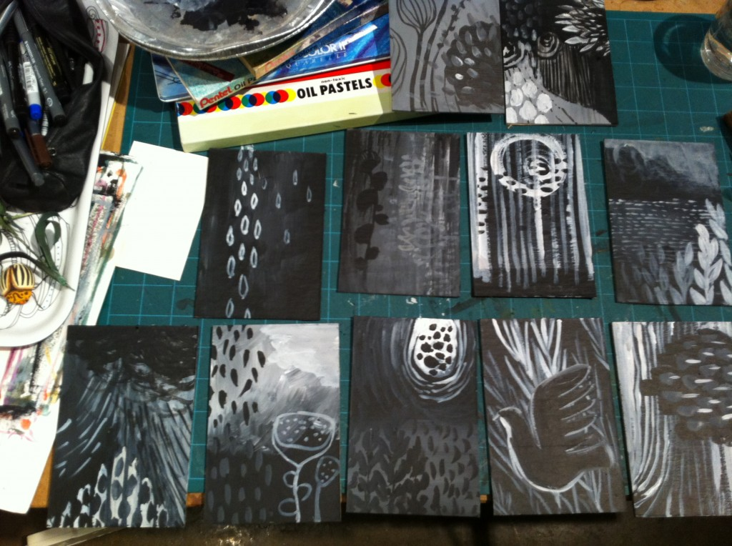 Using black and white gesso on cardboard I created abstract landscapes